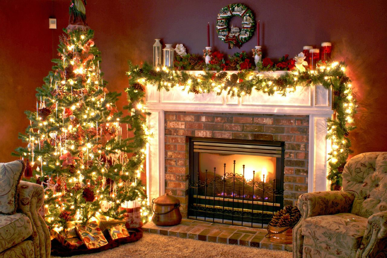 mesmerizing decoration of a white fireplace mantel beside a large christmas tree using a hanging wreath and red roses - How To Decorate A White Fireplace Mantel For Christmas